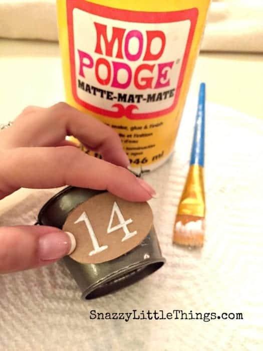 Holding Label on Pottery Barn Knock Off Mod Podge